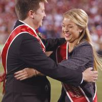 Photo - Michael Nash and Morgan Wolber hug after being announced as Homecoming King and Queen during halftime of the college football game between the University of Oklahoma Sooners (OU) and the Iowa State Cyclones (ISU) at the Glaylord Family-Oklahoma Memorial Stadium on Saturday, Oct. 16, 2010, in Norman, Okla.  Photo by Steve Sisney, The Oklahoman