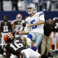 Photo -   Dallas Cowboys kicker Dan Bailey (5) follows through on a field goal under pressure from Cleveland Browns wide receiver Josh Cribbs (16) late in the second half of an NFL football game, Sunday, Nov. 18, 2012, in Arlington, Texas. (AP Photo/Brandon Wade)
