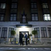 Photo - FILE - In this Monday, Dec. 3, 2012 file photo, policeman stand guard outside the King Edward VII hospital where the Duchess of Cambridge has been admitted with a severe form of morning sickness,  in London .King Edward VII hospital says the nurse involved in Kate hoax call has died, it has been announced, Friday, Dec. 7, 2012. (AP Photo/Alastair Grant, File)