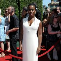 Photo - Uzo Aduba arrives at the 2014 Creative Arts Emmys at Nokia Theatre L.A. LIVE on Saturday, Aug. 16, 2014, in Los Angeles. (Photo by Richard Shotwell/Invision/AP)