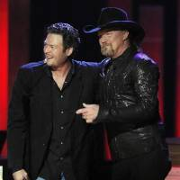 Photo -  Trace Adkins delivers Oklahoma country music star Blake Shelton's invitation to join the Grand Ole Opry on Sept. 28, 2010, in Nashville, Tenn. Shelton now is helping with Opry backstage tours via video. (AP file)