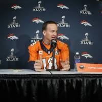 Photo - Denver Broncos quarterback Peyton Manning talks with reporters during a news conference Wednesday, Jan. 29, 2014, in Jersey City, N.J. The Broncos are scheduled to play the Seattle Seahawks in the NFL Super Bowl XLVIII football game Sunday, Feb. 2, in East Rutherford, N.J. (AP Photo/Mark Humphrey)
