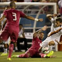 Photo - Real Madrid's Pepe (3) watches as Sergio Ramos, bottom, stops Roma forward Aden Ljajic (8) from moving the ball up field in the first half of a Guinness International Champions Cup soccer tournament match, Tuesday, July 29, 2014, in Dallas. (AP Photo/Tony Gutierrez)