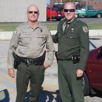 Photo -  Seminole County Game Warden Tyler Howser, right, with his father, Daryl, retired game warden from Seminole County. Photo provided    -