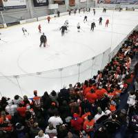 Photo - A capacity crowd of Philadelphia Flyers fans fills the rink to capacity at the first practice session at the team's training camp Sunday, Jan. 13, 2013, in Voorhees, NJ. The Flyers, and other NHL teams, returned after a 113-day lockout ended with an settlement on a new collective bargaining agreement. (AP Photo/Tom Mihalek)