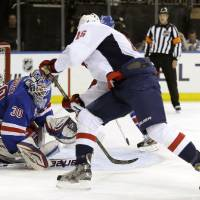 Photo - Washington Capitals right wing Eric Fehr (16)] shoots as New York Rangers goalie Henrik Lundqvist (30), of Sweden, defends in the first period of Game 6 of their NHL Stanley Cup hockey playoff series in New York, Sunday, May 12, 2013. (AP Photo/Kathy Willens)