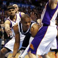 Photo - Oklahoma City Thunder's Russell Westbrook (0) looks for a passing lane as the Oklahoma City Thunder play the Phoenix Suns in NBA basketball at the Chesapeake Energy Arena in Oklahoma City, on Monday, Dec. 31, 2012.  Photo by Steve Sisney, The Oklahoman