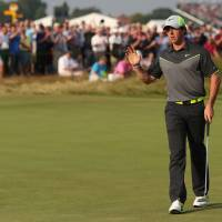Photo - Rory McIlroy of Northern Ireland acknowledges the crowd after playing a birdie on the 17th hole during the second day of the British Open Golf championship at the Royal Liverpool golf club, Hoylake, England, Friday July 18, 2014. (AP Photo/Scott Heppell)