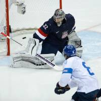 Photo - Teemu Selanne of Finland scores a goal on goalkeeper Jonathan Quick of the United States during the second period of the men's bronze medal ice hockey game at the 2014 Winter Olympics, Saturday, Feb. 22, 2014, in Sochi, Russia. (AP Photo/Matt Slocum)