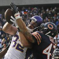 Photo -   Chicago Bears safety Chris Conte (47) breaks up a pass intended for Minnesota Vikings tight end Kyle Rudolph (82) in the first half of an NFL football game in Chicago, Sunday, Nov. 25, 2012. (AP Photo/Charles Rex Arbogast)