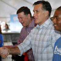 Photo -   Republican Presidential candidate Mitt Romney, center, shakes hands of supporters prior to the NASCAR Sprint Cup Series auto race at the Richmond International Raceway in Richmond, Va., Saturday, Sept. 8, 2012. (AP Photo/Steve Helber)
