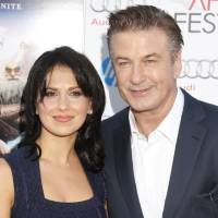 Photo - FILE - This Nov. 4, 2012 file photo shows actor Alec Baldwin, right, and his wife Hilaria Thomas at the
