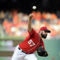 Photo - Washington Nationals starting pitcher Tanner Roark (57) delivers a pitch against the Baltimore Orioles during the first inning of a baseball game, Monday, Aug. 4, 2014, in Washington. (AP Photo/Nick Wass)