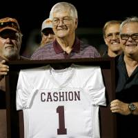 Photo - Former Cashion coach Larry Mantle is presented with a jersey by his former players as he is honored during halftime of Cashion's high school football game against Minco in Cashion, Okla., Friday, Sept. 27, 2013. Photo by Bryan Terry, The Oklahoman