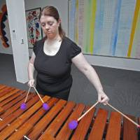 Photo - University of Oklahoma World Music Professor Christine Souza performs at a Tuesday Noon Concert in 2011. Souza opens this semester's series of concerts Tuesday. PHOTO BY STEVE SISNEY, THE OKLAHOMAN ARCHIVES