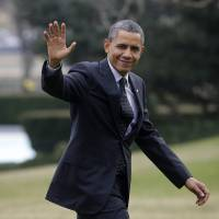 Photo - President Barack Obama waves as he walks across the South Lawn of the White House in Washington, Thursday, Feb. 7, 2013, following his arrival on Marine One helicopter from the House Democratic Issues Conference in Lansdowne, Va. (AP Photo/Pablo Martinez Monsivais)