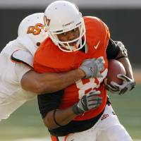 Photo - ORANGE AND WHITE GAME / COLLEGE FOOTBALL: OSU's Wilson Youman (86) tries to break a tackle after a catch during the Orange and White spring football game for the Oklahoma State University Cowboys at Boone Pickens Stadium in Stillwater, Okla., Saturday, April 18, 2009. The Orange team won, 20-15. Photo by Nate Billings, The Oklahoman ORG XMIT: KOD