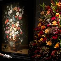 Photo - A Christie's employee adjusts a painting by Jan Breughel entitled 'Lilies, irises, roses and other flowers' during a press preview at the auction house in London, Friday, Nov.  30, 2012. The painting has an estimated sale price of 1-1.5 million pounds (US$ 1.6-2.4 million, euro 1.25-1.85 million) when sold at auction on Dec.4 . (AP Photo/Alastair Grant)