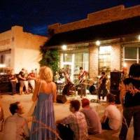 Photo - A crowd gathers outside to listen to a band in the Plaza District, a revitalized stretch of NW 16 between Classen Drive and Pennsylvania Avenue. The area has become an Oklahoma City arts center, hosting frequent outdoor events. Photos provided