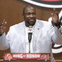 Photo - Former Tampa Bay Buccaneers defensive tackle Warren Sapp gestures while being inducted into the Buccaneers' Ring of Honor Thursday, May 2, 2013, in Tampa, Fla. (AP Photo/Chris O'Meara)