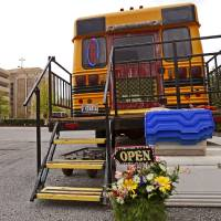 Photo - A 1985 school bus that is used as a farmers market is parked outside Oklahoma Heart Hospital in Oklahoma City.