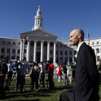 Photo -   Brian Vicente co-director of the Yes on 64 campaign waits to start a news conference about the legalization of marijuana at Civic Center Park in Denver on Wednesday, Nov. 7, 2012. Colorado voters passed Amendment 64 on Tuesday legalizing marijuana in Colorado for recreational use. (AP Photo/Ed Andrieski)