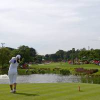 Photo -   Inbee Park of South Korea tees off on the 3rd hole during the final round of the LPGA Malaysia golf tournament at Kuala Lumpur Golf and Country Club in Kuala Lumpur, Malaysia, Sunday, Oct. 14, 2012. (AP Photo/Lai Seng Sin)