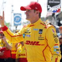 Photo - Ryan Hunter-Reay gestures after winning the pole position at IndyCar qualifying for the Grand Prix of Long Beach auto race on Saturday, April 12, 2014, in Long Beach, Calif. (AP Photo/Alex Gallardo)