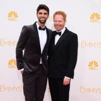 Photo - Justin Mikita, left, and Jesse Tyler Ferguson arrive at the 66th Annual Primetime Emmy Awards at the Nokia Theatre L.A. Live on Monday, Aug. 25, 2014, in Los Angeles. (Photo by Jordan Strauss/Invision/AP)