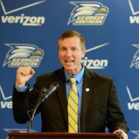 Photo - Willie Fritz gestures during a news conference where he was named the new head NCAA college football coach at Georgia Southern University in Statesboro, Ga., Friday, Jan. 10, 2014.  (AP Photo/The Morning News, Richard Burkhart)  THE EXAMINER.COM OUT; SFEXAMINER.COM OUT; WASHINGTONEXAMINER.COM OUT