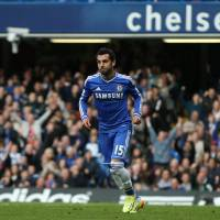 Photo - Chelsea's Mohamed Salah turns as he celebrates after scoring the opening goal of the English Premier League soccer match between Chelsea and Stoke City at Stamford Bridge stadium in London, Saturday, April, 5, 2014. (AP Photo/Alastair Grant)