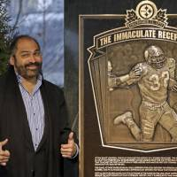 Photo - Hall of Fame running back, Pittsburgh Steelers' Franco Harris stands on the spot of the