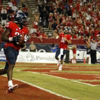 Photo - OSU / CELEBRATION: Arizona's Ka'Deem Carey (25) celebrates a touchdown during the college football game between the University  of Arizona and Oklahoma State University at Arizona Stadium in Tucson, Ariz.,  Saturday, Sept. 8, 2012. Photo by Sarah Phipps, The Oklahoman