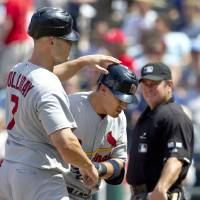 Photo -   St. Louis Cardinals' Allen Craig, center, is congratulated by teammate Matt Holliday (7) after hitting two-run home run in the seventh inning of a baseball game against the Kansas City Royals at Kauffman Stadium in Kansas City, Mo., Saturday, June 23, 2012. (AP Photo/Orlin Wagner)