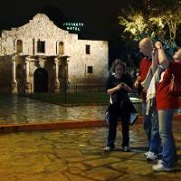 Photo - REX LYKINS, OU: Charlotte Waggner of Yukon and Rex and Shirley Lykins of Oklahoma City walk in front of the Alamo in San Antonio, Texas on Tuesday, Nov. 30, 2007.  The University of Oklahoma fans are in town for the Saturday Big 12 Championship college football game between the Sooners and the University of Missouri.   BY STEVE SISNEY, THE OKLAHOMAN ORG XMIT: KOD
