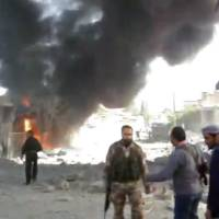 Photo -   This image taken from video obtained from Shaam News Network, which has been authenticated based on its contents and an Associated Press journalist who saw a plane bomb an area around the Syrian-Turkish border town of Ras al-Ayn, shows Syrians inspecting the damage and looking for victims moments after an airstrike by Syrian warplanes in Ras al-Ayn, Syria, Monday, Nov. 12, 2012. (AP Photo/Shaam News Network via AP video)