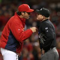 Photo - St. Louis Cardinals manager Mike Matheny argues with home plate umpire Sean Barber after Barber ejected center fielder Peter Bourjos in fourth inning against the Atlanta Braves in a baseball game Friday, May 16, 2014, at Busch Stadium in St. Louis. (AP Photo/St. Louis Post-Dispatch, Chris Lee) EDWARDSVILLE OUT  ALTON OUT