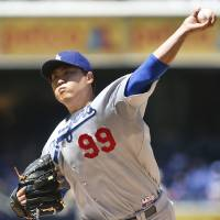 Photo - Los Angeles Dodgers starting pitcher Hyun-Jin Ryu works against the San Diego Padres in the first inning of a baseball game Sunday, Aug. 31, 2014, in San Diego.  (AP Photo/Lenny Ignelzi)
