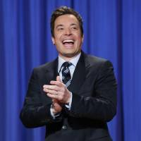 Photo - FILE - This April 4, 2013 file photo released by NBC shows Jimmy Fallon, host of