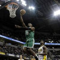 Photo - Boston Celtics' Jeff Green (8) goes up for a shot against Indiana Pacers' Roy Hibbert (55) during the first half of an NBA basketball game Wednesday, March 6, 2013, in Indianapolis. (AP Photo/Darron Cummings)