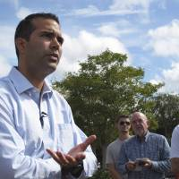 Photo -   FILE - In this Sept. 17, 2012 photo, George P. Bush speaks with Florida State University students before beginning a bus tour in Tallahassee, Fla. A Texas official on Thursday, Nov. 8, 2012 said Bush, nephew of former President George W. Bush, has made a campaign filing that is required for someone to run for office in his home state. (AP Photo/Brendan Farrington, File)