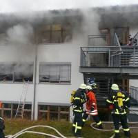 Photo -   In this image taken from video firefighters try to extinguish flames in a workshop for disabled people in Titisee-Neustadt, southwestern Germany, Monday, Nov. 26, 2012. Firefighters said the fire has killed 14 and injured at least six others. There was no immediate information on why the building in Titisee-Neustadt, near the city of Freiburg, caught fire Monday. (AP Photo/dapd, Kamera24.TV)