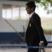 Photo - Italy's Gianluigi Buffon walks to his team's bus after arriving to the Galeao Air Base for the World Cup in Rio de Janeiro, Brazil, Friday, June 6, 2014. The Italian team will be based at a resort in Mangaratiba during the  World Cup. (AP Photo/Leo Correa)