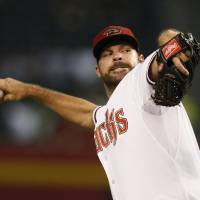 Photo - Arizona Diamondbacks starting pitcher Josh Collmenter throws in the first inning during a baseball game against the San Diego Padres, Friday, Aug. 22, 2014, in Phoenix. (AP Photo/Rick Scuteri)