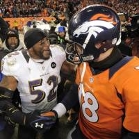Photo - Baltimore Ravens inside linebacker Ray Lewis shakes hands Denver Broncos quarterback Peyton Manning (18) after the Ravens won 38-35 in overtime of an AFC divisional playoff NFL football game, Saturday, Jan. 12, 2013, in Denver. (AP Photo/Jack Dempsey)