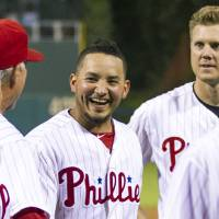 Photo - FILE - In a Sept. 7, 2013 file photo, Philadelphia Phillies' Freddy Galvis, center, celebrates with teammates following a baseball game against the Atlanta Braves, in Philadelphia. Phillies reserve infielder Galvis has been diagnosed with an infection caused by MRSA, general manager Ruben Amaro Jr. said Friday, March 21, 2014. MRSA, or Methicillin-resistant Staphylococcus aureus, is a staph bacteria that can cause infections and is resistant to many antibiotics. Galvis was hospitalized Thursday and treated with oral and intravenous antibiotics.  (AP Photo/Chris Szagola, File)