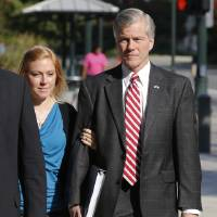 Photo - Former Virginia Gov. Bob McDonnell arrives at federal court with his daughter Cailin Young, in Richmond, Va., Thursday, Aug. 21, 2014. McDonnell begins the second day of testimony in his own defense on corruption charges. (AP Photo/Steve Helber)