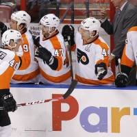Photo - Philadelphia Flyers center Vincent Lecavalier (40) celebrates with teammates after scoring a goal  during the second period of an NHL hockey game in Sunrise, Fla., on Tuesday, April 8, 2014. (AP Photo/Terry Renna)