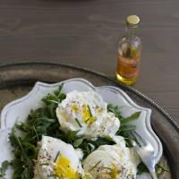 Photo - Poached eggs over ricotta cheese on arugula.  MATTHEW MEAD - AP