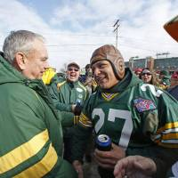 Photo -   Tommy Thompson, republican candidate for U.S. senate and former Gov. of Wis, greets people while tailgating at Lambeau Field before the Green Bay Packers and Arizona Cardinals NFL football game Sunday, Nov. 4, 2012, in Green Bay, Wis. (AP Photo/Jeffrey Phelps)